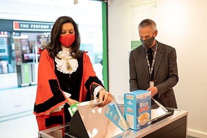 Photograph of the Mayor of Bromley, Councillor Hannah Gray, and Mark Haynes, The Glades Centre Director, at the official opening of the Foodbank